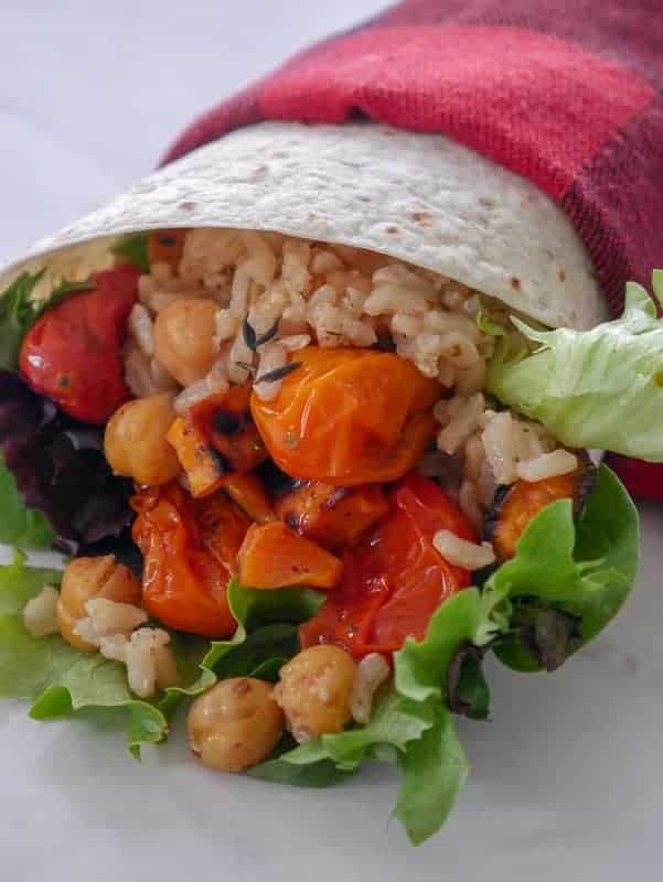 Lunch wrap meal prep with brown rice, chickpeas, and roasted veggies