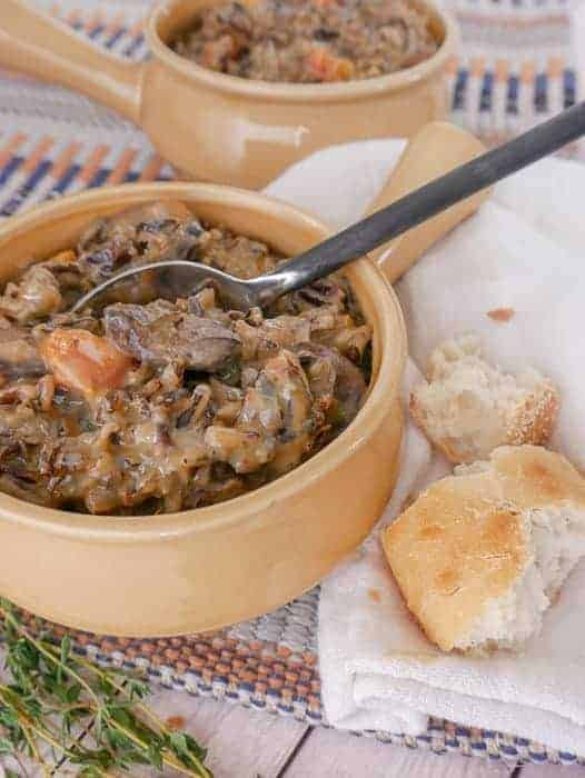 side view of vegetarian wild rice soup with mushrooms