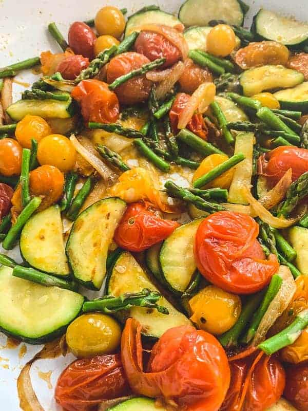 smashed tomatoes and balsamic vegetables in a white pan