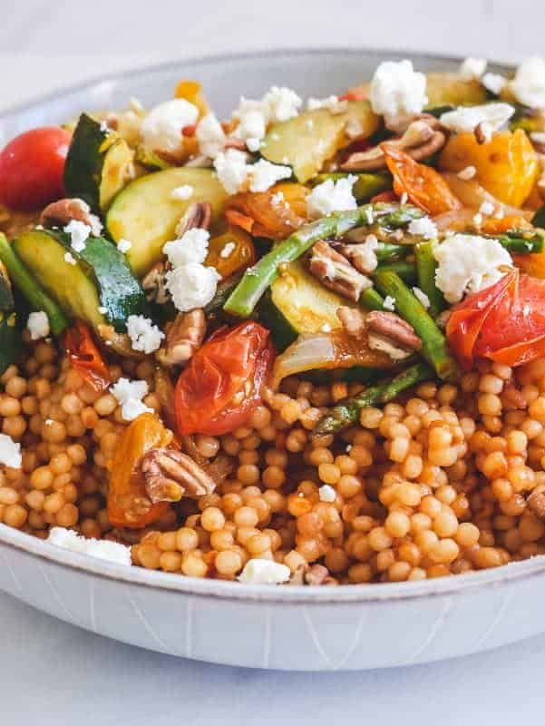 close-up of one-pan Pearl Couscous & Smashed Tomato Veg in a white bowl