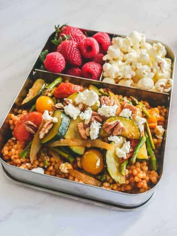 One-Pan Pearl Couscous served with Smashed Tomatoes and Balsamic Vegetables in lunch container