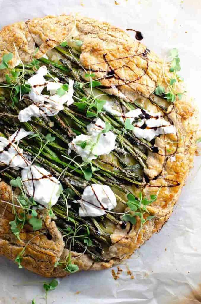 Recipe featuring April produce: Round savory pastry crust with asparagus, cheese and spring microgreens