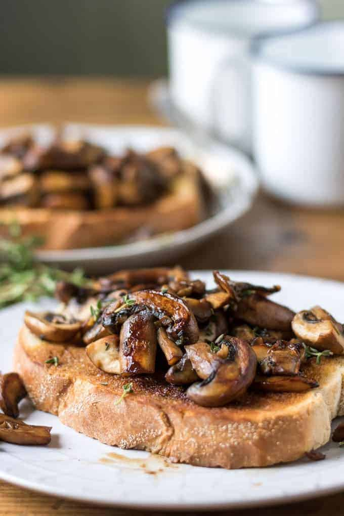 Mushrooms and herbs on top of toasted bread