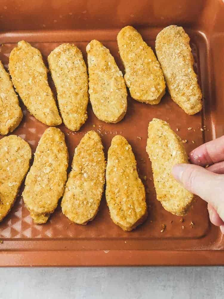 """Frozen meatless """"chicken"""" tenders bake in the oven or toaster oven"""