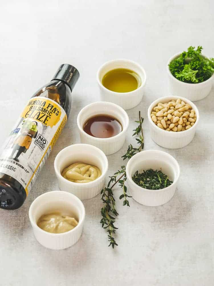 ingredients for Tahini Maple Dijon Dressing in small white dishes