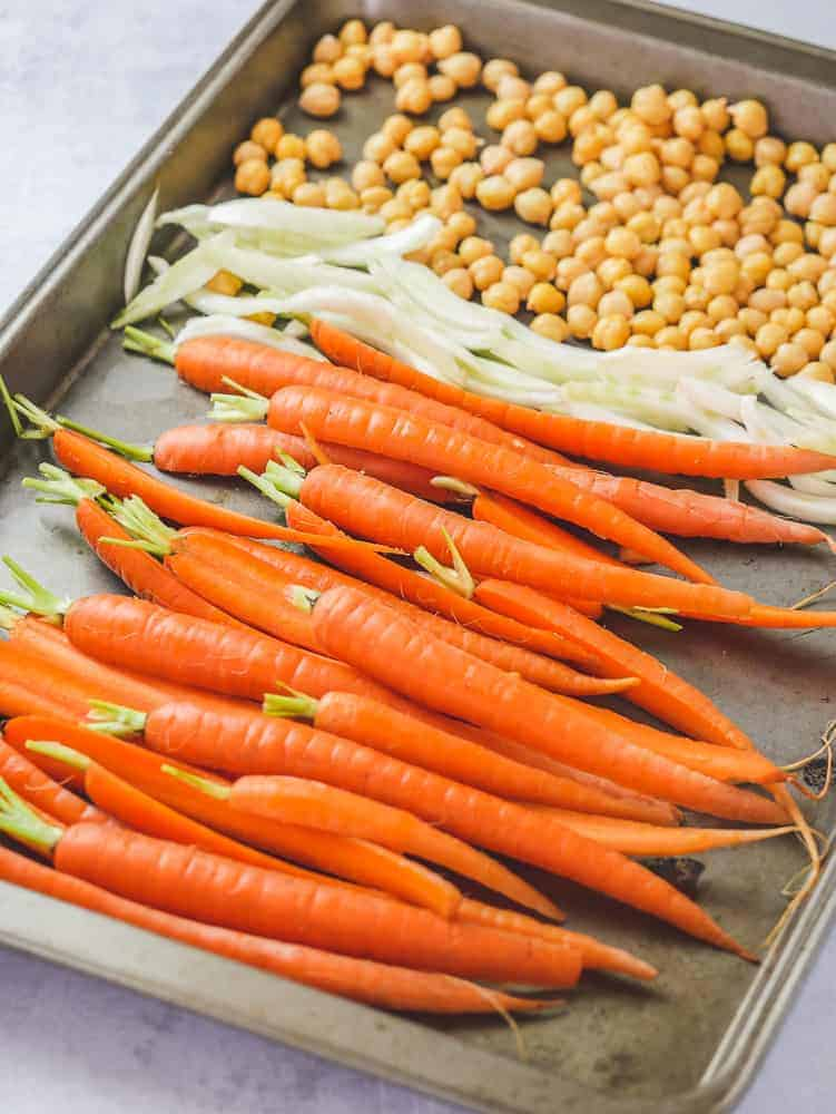 Carrots, fennel and chickpeas on a sheet pan ready for roasting