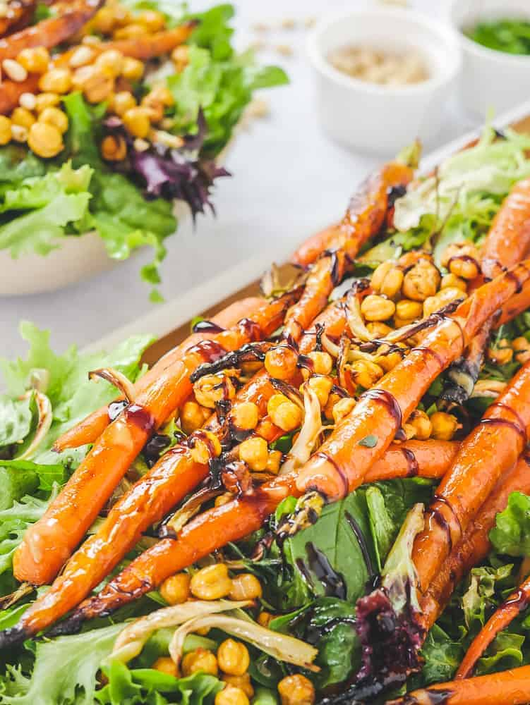 close-up of warm roasted vegetable salad served on a wooden board