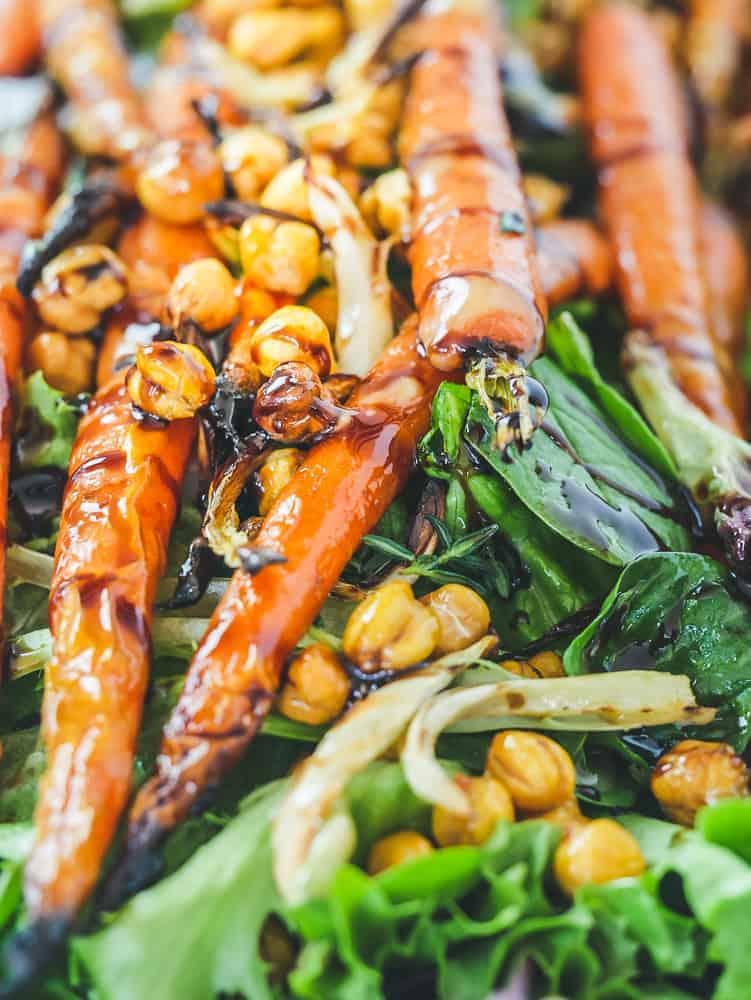 close-up of roasted carrots, fennel and chickpeas on a sheet pan