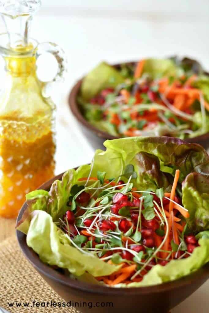 Lettuce leaf cups filled with microgreens and pomegranate arils