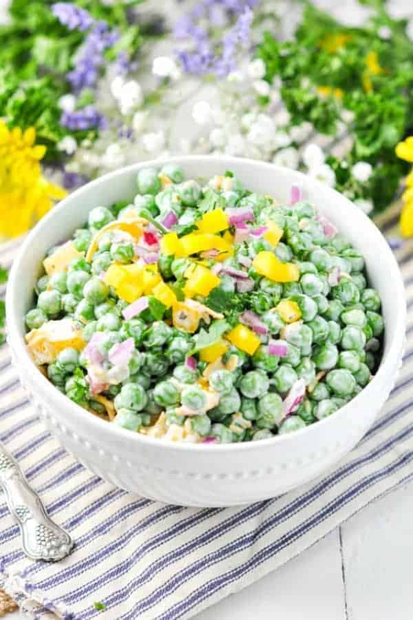 Creamy spring peas with diced yellow pepper and red onion on top