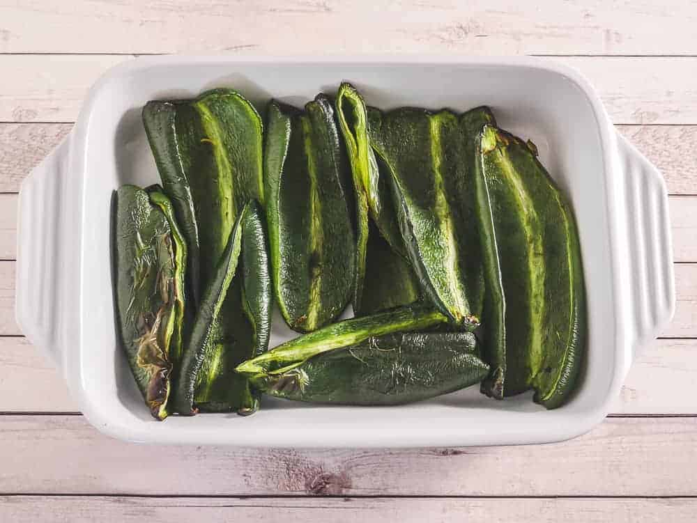 charred poblano peppers in a casserole dish