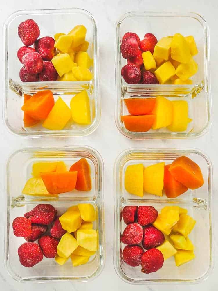 Meal Prep Smoothies: 4 food storage containers with fruit ice cubes, frozen strawberries and frozen mango