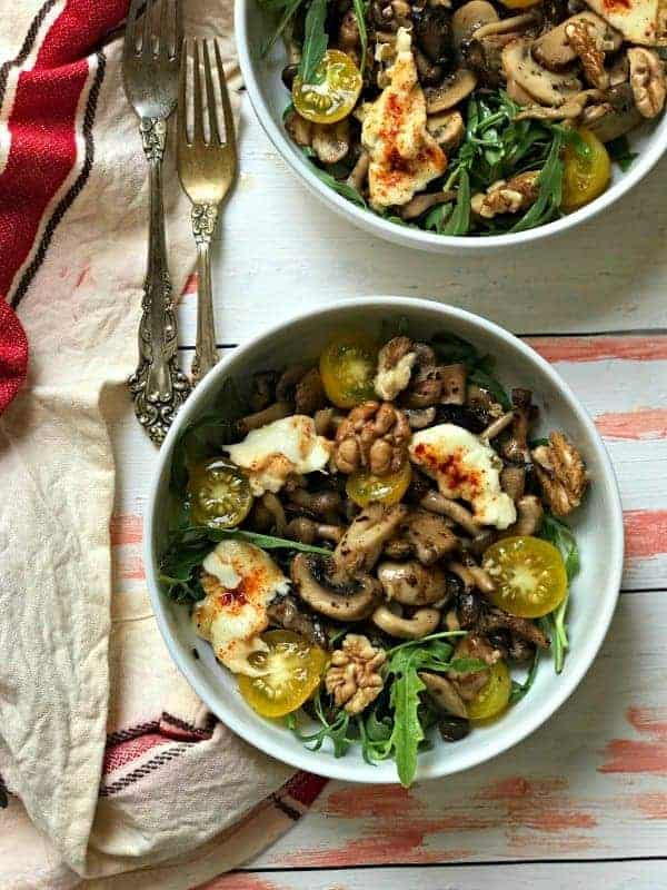 Bowl of salad with mushrooms and other vegetables