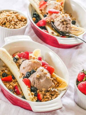 banana topped with almond milk frozen yogurt, granola and fresh berries