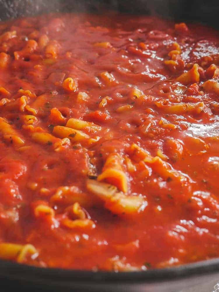 Cook pasta in simmering sauce for 20 minutes, covered.