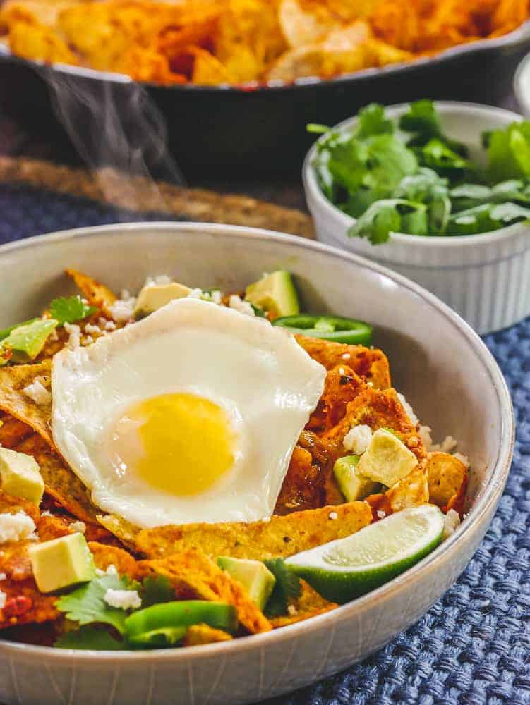 Fried egg steaming on top of chilaquiles