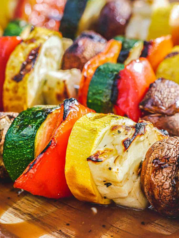 Grilled halloumi kebabs with colorful chopped vegetables