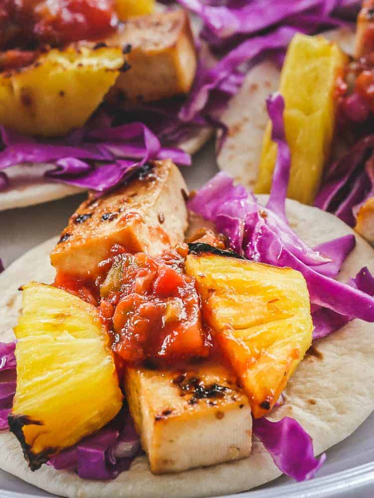 Teriyaki tofu and grilled pineapple in a tofu taco