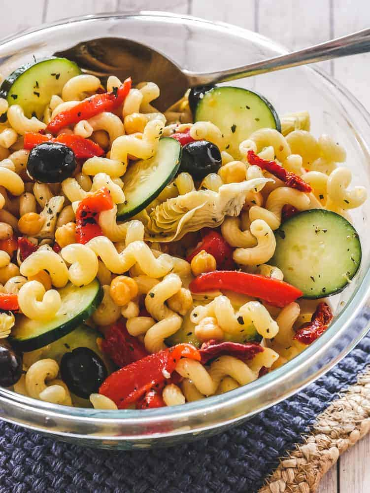Vegan Pasta Salad in a Glass Bowl with Serving Spoon
