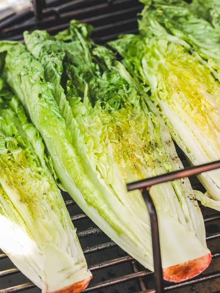 romaine lettuce heads on an outdoor grill