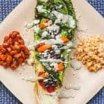 Grilled romaine salad with sides of corn and beans