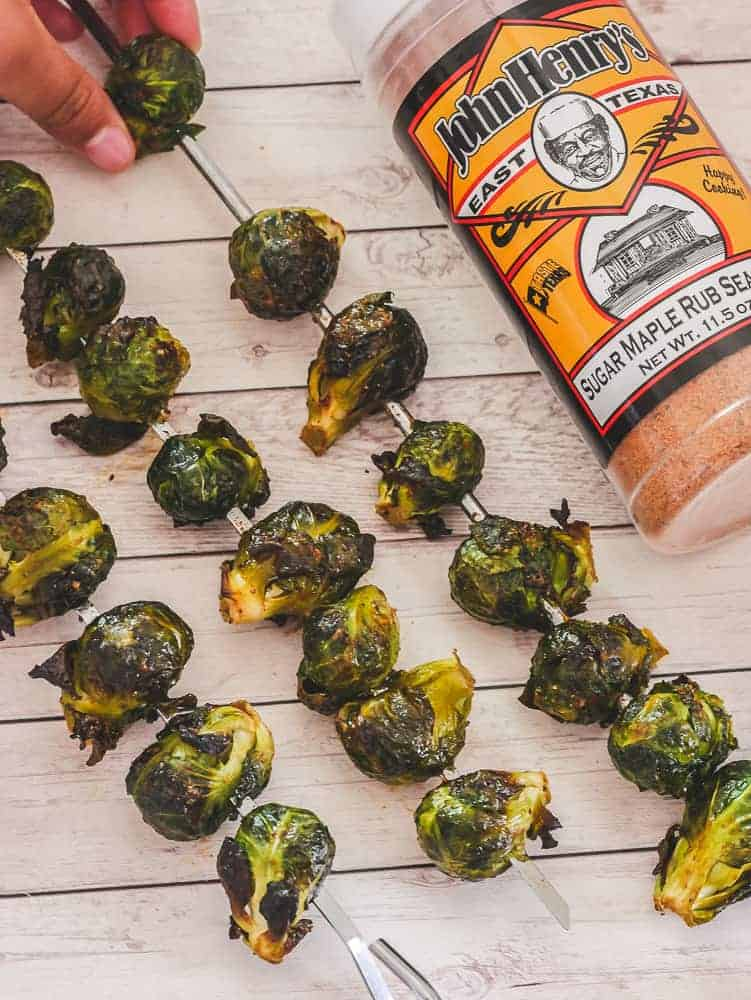 make brussel sprouts in oven by putting on skewers, with sweet BBQ rub on the side