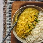 Red Lentil Curry and White Rice in a Bowl with a Spoon