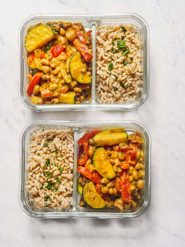 Curried Black Eyed Peas Recipe in Meal Prep Containers on Marble Counter