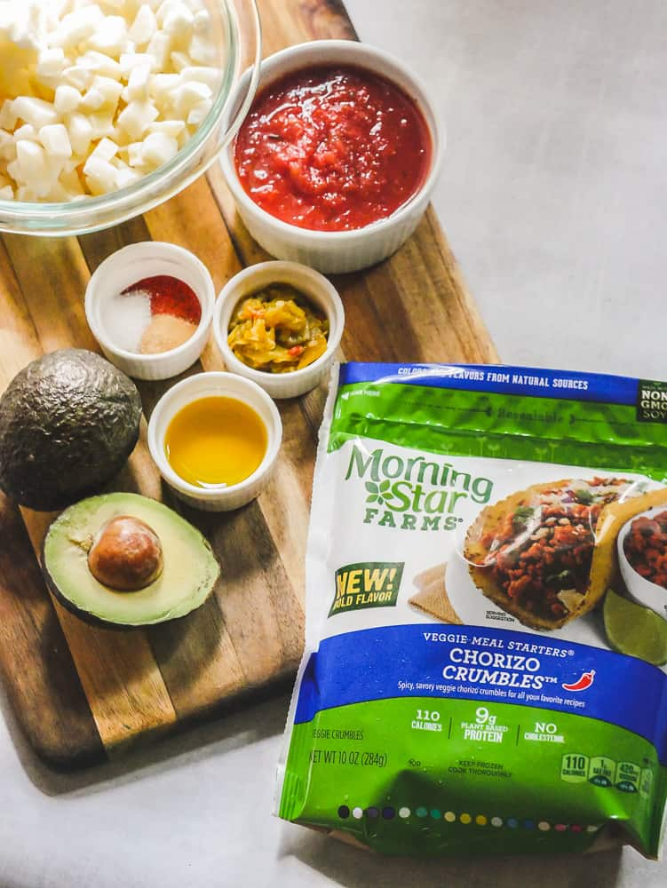 Ingredients arranged on a cutting board with a bag of frozen Morning Star Farms chorizo crumbles