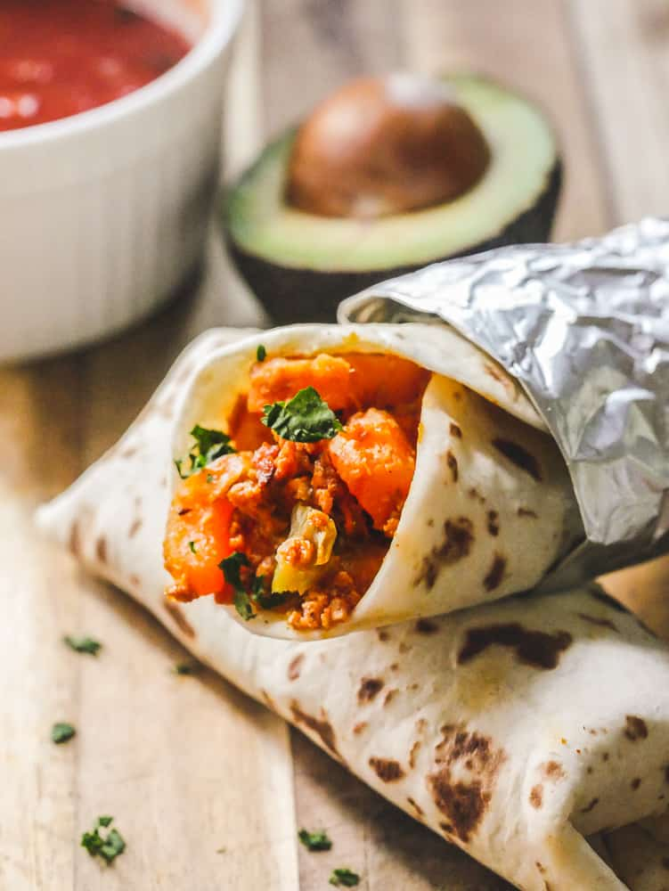 breakfast burrito rolled in aluminum foil