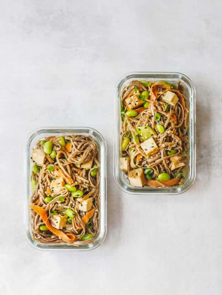 2 glass food storage containers filled with soba noodle bowl ingredients