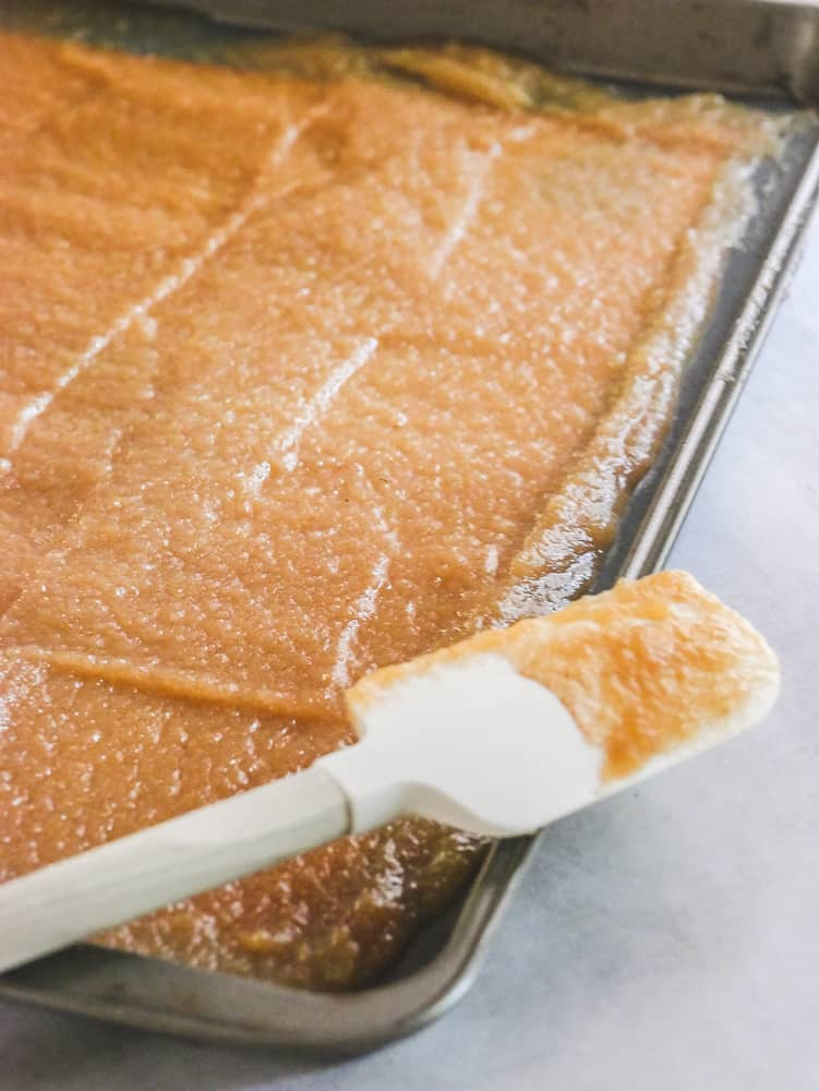 Applesauce spread into a thin layer on a baking sheet