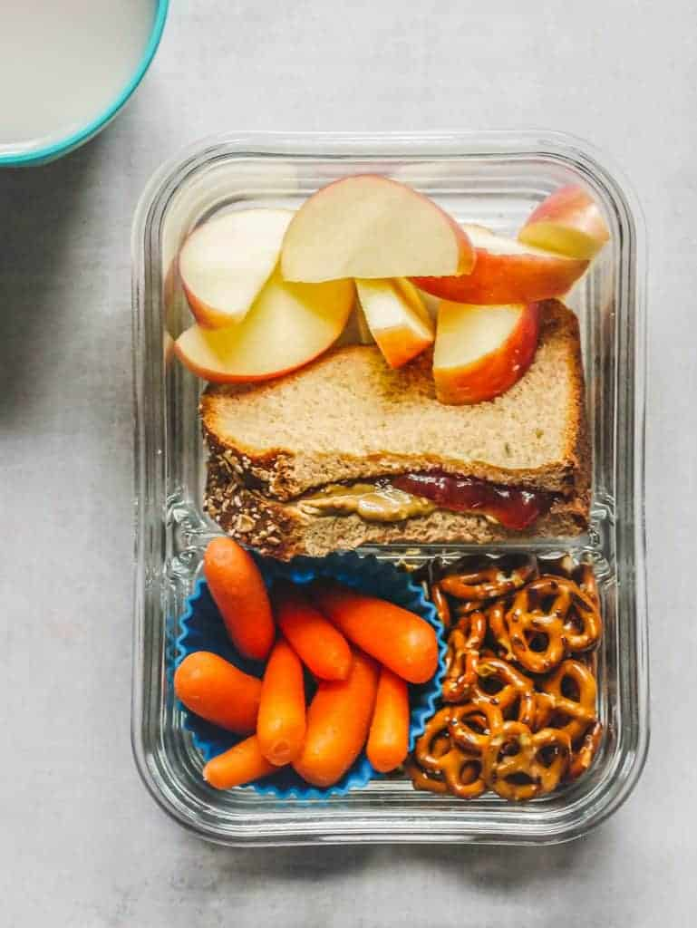peanut butter and jelly, sliced apples, pretzels and baby carrots