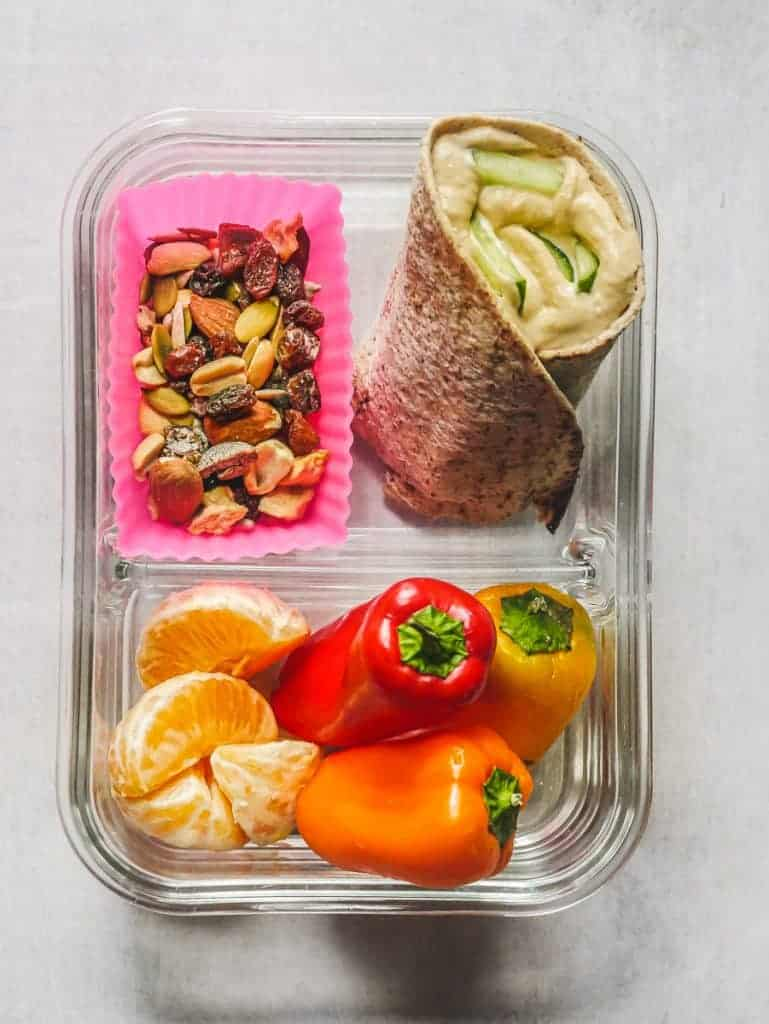 hummus and cucumber wrap, trail mix, sweet peppers and mandarin orange