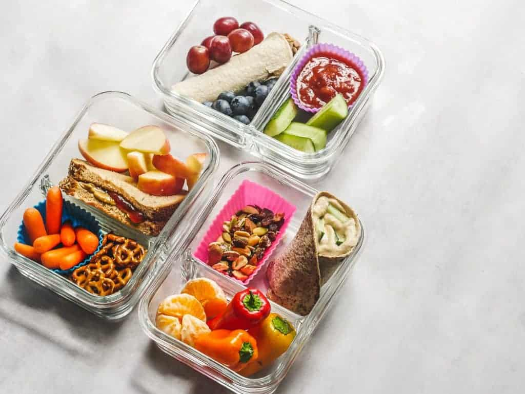 three food storage containers with different kid lunch box meal ideas