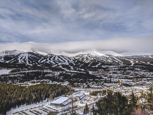 Landscape photo of a ski resort town with mountains