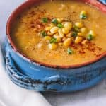 ceramic bowl filled with yellow vegan corn soup