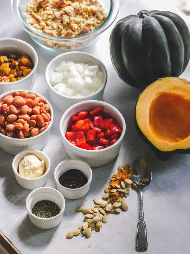 ingredients to make stuffed acorn squash arranged in small bowls